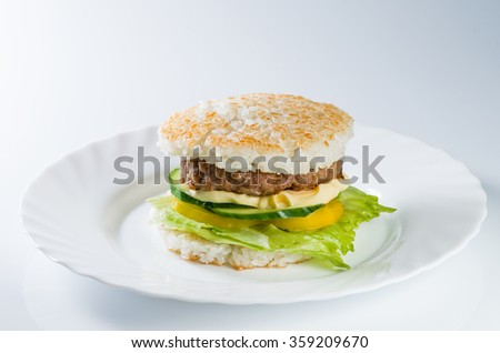 Japanese food, grilled meat in Rice burger, served on plate (shallow DOF) - stock photo
