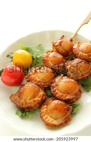 Japanese food, grilled scallop with Teriyaki sauce served with salad