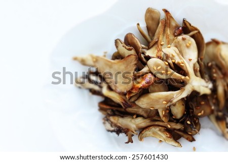 Japanese food, Maitake mushroom and sesame seed stir fried - stock photo