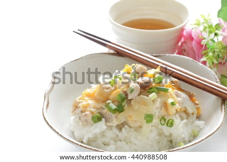 Japanese food, Oyako Don chicken and egg on rice with tea - stock photo