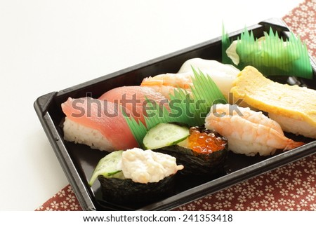 Japanese food, packed Nigiri sushi for lunch image - stock photo