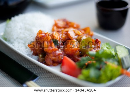 Japanese food. Perch with rice and vegetables - stock photo