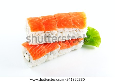 Japanese food. Philadelphia roll with salmon and cream cheese. Eight pieces, over white. Selective focus. - stock photo