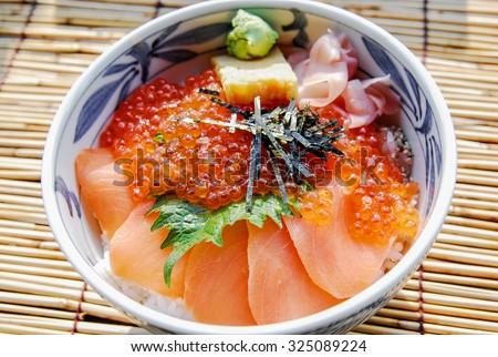 Japanese food, raw fishes, called sashimi, on the rice - stock photo
