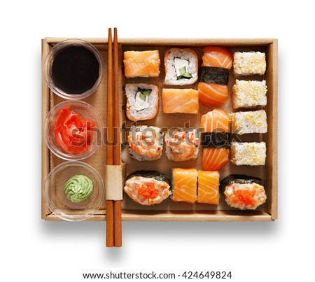 Japanese food restaurant, sushi maki gunkan roll plate or platter set. Chopsticks, ginger, soy sauce, wasabi. Sushi isolated at white background, take away, delivery box. Top view. - stock photo