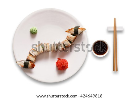 Japanese food restaurant, sushi unagi gunkan roll plate or platter set. Chopsticks, ginger, wasabi and soy sauce. Sushi with eel at white round plate isolated at white background. - stock photo