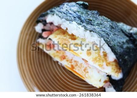 Japanese food, rice sandwich Fried egg Onigirizu - stock photo