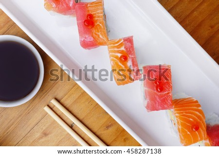 Japanese food roll with red fish