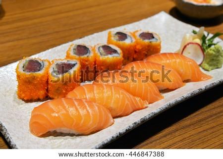 Japanese food - Sushi and Sashimi, Sushi set: sushi roll with salmon and sushi roll .selective focus. - stock photo
