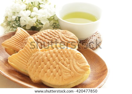Japanese food, Taiyaki pan cake and tea - stock photo