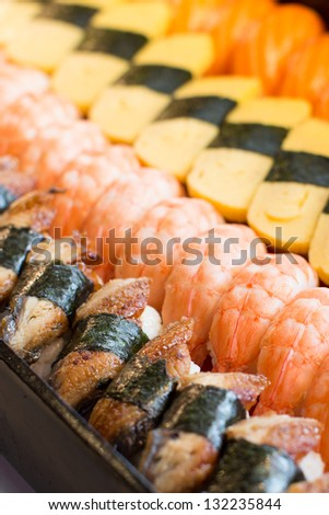 Japanese food, various types of sushi, fish, shrimp, egg, raw fish