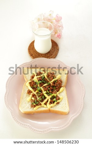 Japanese fusion food, Natto and mayonnaise on toast with milk on back - stock photo