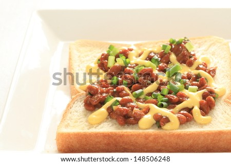 Japanese fusion food, Natto on toast with mayonnaise for healthy food image - stock photo