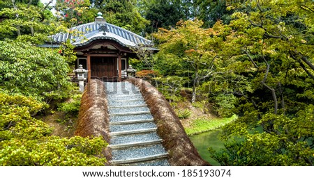 Japanese garden landscape with steps leading to a beautiful traditional tea house. Location: The Katsura Imperial Villa in Kyoto, Japan.  - stock photo