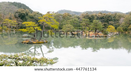 Japanese garden on cloudy day - stock photo