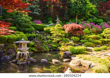 Japanese garden with pond behind house
