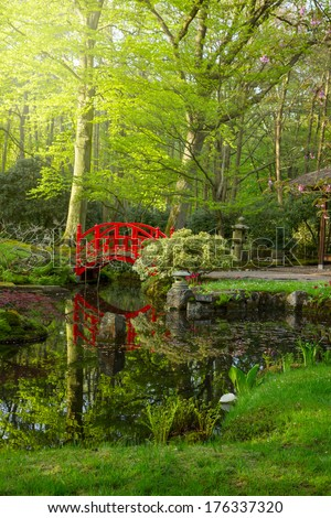 Japanese garden with red bridge at sunny day, Den Haag, Holland - stock photo