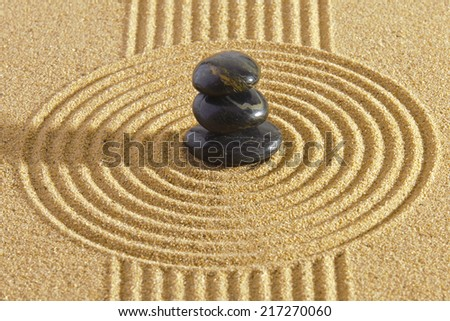 Japanese garden with rocks in sand and yin and yang - stock photo
