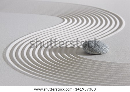 Japanese garden with stone in raked sand - stock photo
