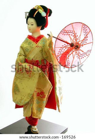 japanese geisha doll(frontal view,back lighting)-over white background - stock photo