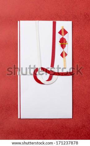 japanese gift envelopes on red background - stock photo