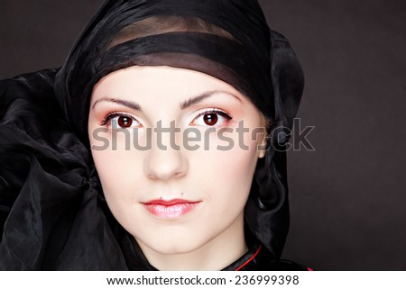 Japanese girl in the image in the studio, removing the lens Lensbaby - stock photo
