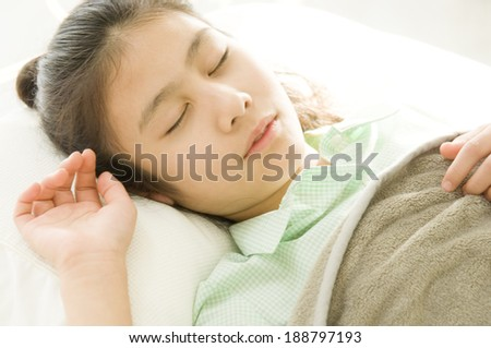 Japanese girl taking nap in bed