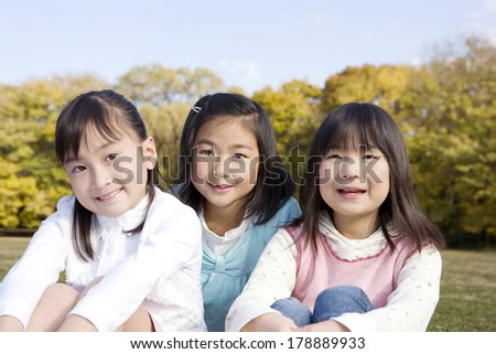 Japanese Girls sitting in the park