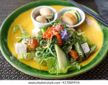 japanese green vegetables salad and chopsticks - stock photo