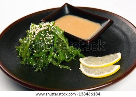 Japanese hiyashi salad with peanut sauce wakame - stock photo