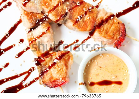 Japanese kebabs with salmon. Traditional Oriental food. Tasty and nutritious - stock photo