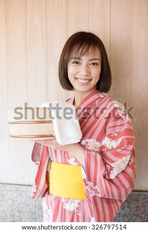 Japanese kimono woman going to a hot spring - stock photo