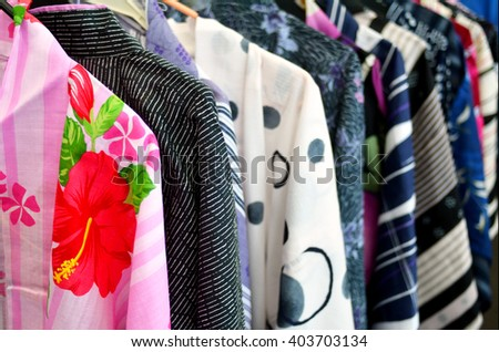 Japanese kimonos on display in a clothing shop - stock photo