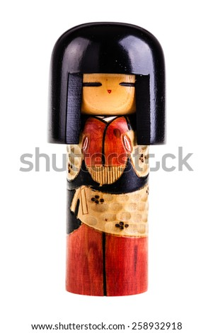Japanese kokeshi doll made of wood isolated over a white background - stock photo