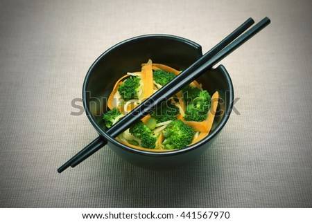 Japanese lunch, bowl with japanese sticks, japanese style pasta  - stock photo