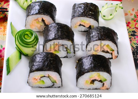 japanese maki sushi rolls set with salmon and avocado - stock photo