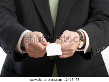 Japanese manner of man's hands presenting buiness card - stock photo