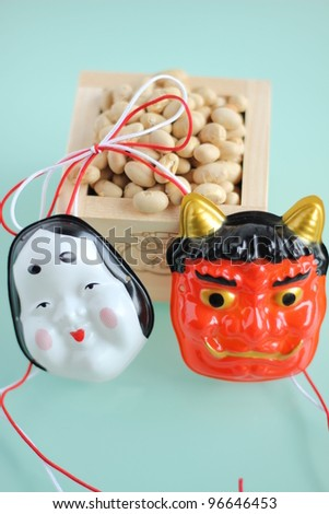 Japanese mask with soy beans - stock photo