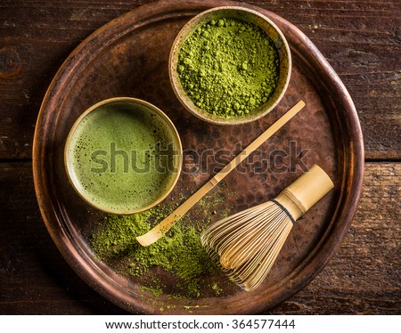 Japanese matcha green powdered tea served in matcha bowl - stock photo