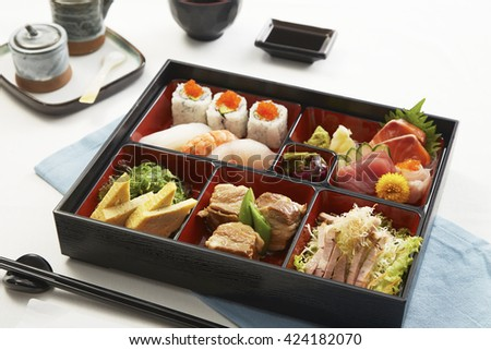 Japanese Meal in a Box (Bento) on white background - stock photo