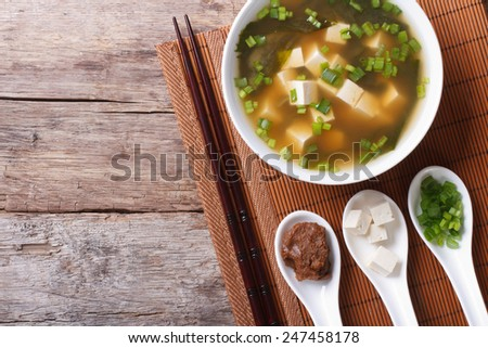 Japanese miso soup and ingredients on the table. top view of a horizontal  - stock photo