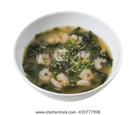 Japanese miso soup with shrimps and kombu seaweed. Isolated on a white background. - stock photo
