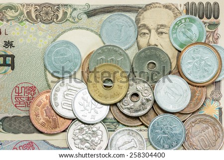 Japanese money yen banknote and coins close up. - stock photo