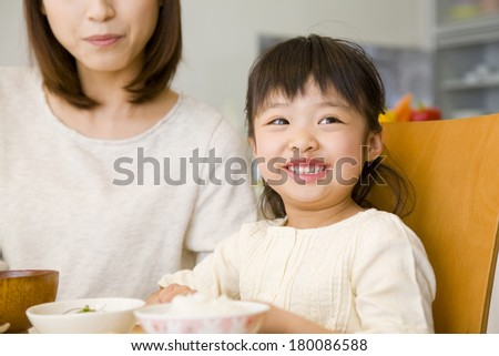 Japanese mother and daughter at the table