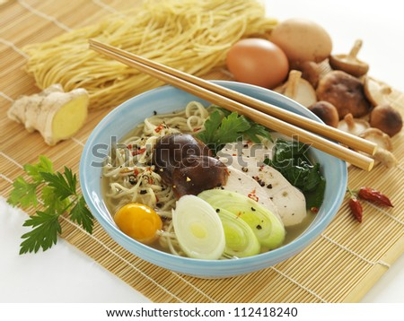Japanese noodle soup in blue porcelain soup plate - stock photo