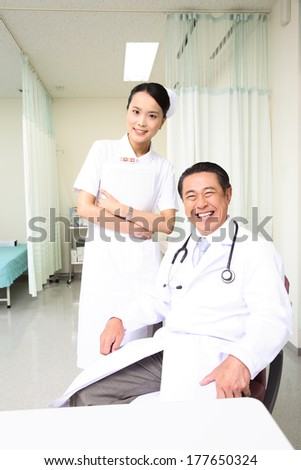 Japanese Nurse and Doctor portrait - stock photo