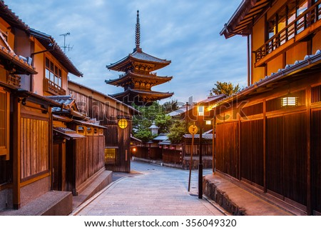 Japanese pagoda and old house in Kyoto at twilight - stock photo