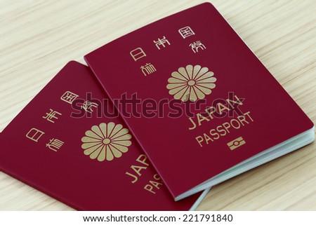 Japanese passports on the table - stock photo