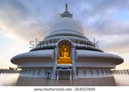 Japanese Peace Pagoda In Rumassala, Sri Lanka. The Japanese Peace Pagoda Near Unawatuna Is A Beautiful Shrine With Amazing Views Across Indian Ocean And Galle Dutch Fort - stock photo