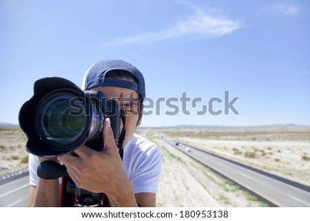 Japanese photographer taking photos - stock photo